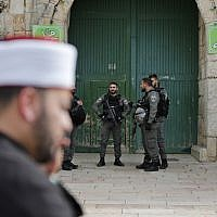 Border Police officers secure one of the entrances of the Temple Mount compound in the Old City of Jerusalem after closing the access to the site on March 12, 2019. (Ahmad Gharabli/AFP)