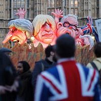 Models of prominent Brexit politicians are driven past the Houses of Parliament in London on March 12, 2019, ahead of the second meaningful vote on the government's Brexit deal. (Tolga Akmen/AFP)