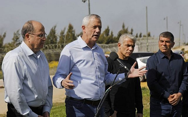 Left to right: Blue and White alliance leaders Moshe Ya'alon, Benny Gantz, Yair Lapid and Gabi Ashkenazi speak to the press during a tour of the border between Israel and the Gaza Strip, near Kibbutz Kfar Aza, on March 13, 2019. (Menahem Kahana/AFP)