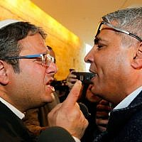 Otzma Yehudit's Itamar Ben Gvir (L) argues with Arab Israeli candidate Ata Abu Madighem after a hearing at the Supreme Court in Jerusalem on March 14, 2019. (Gil Cohen-Magen/AFP)