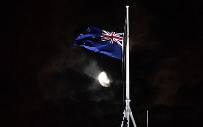 The New Zealand national flag is flown at half-mast on a Parliament building in Wellington on March 15, 2019, after a shooting incident in Christchurch. Attacks on two Christchurch mosques left at least 49 dead on March 15, with one gunman, identified as an Australian extremist, apparently livestreaming the assault that triggered the lockdown of the New Zealand city. (Marty Melville/AFP)