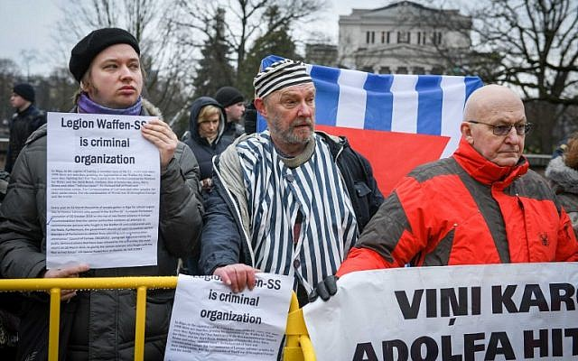 Latvians march to honor troops who fought alongside Nazis