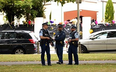 Armed police stay guard in front of the Al Noor mosque in Christchurch on March 18, 2019, four days after 50 worshippers were killed in two mosques attacks, the worst on Muslims in a Western country. (Photo by DAVID MOIR / AFP)