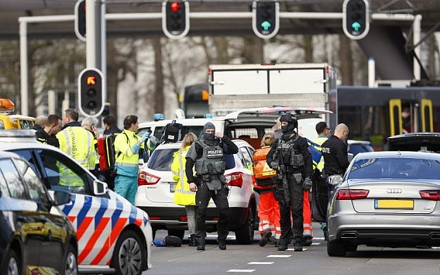 Police forces stand at the 24 Oktoberplace in Utrecht, on March 18, 2019 where a shooting took place. (Robin van Lonkhuijsen / ANP / AFP)