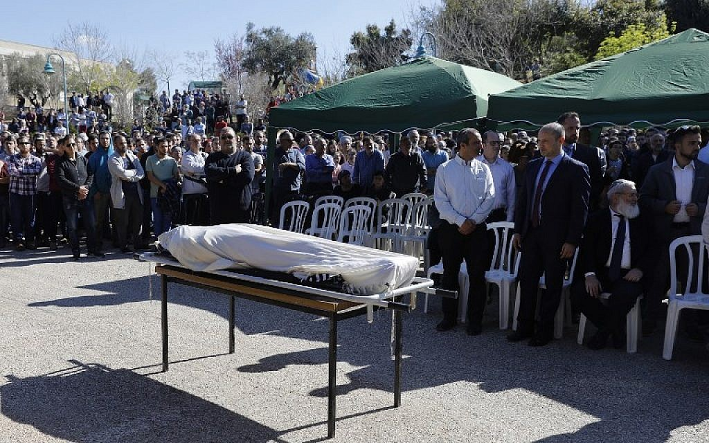 Mourners surround the body of 47-year-old Rabbi Ahiad Ettinger, who died from his injuries sustained a day earlier during a gun and knife attack, during his funeral in the West Bank settlement of Eli, on March 18, 2019.(MENAHEM KAHANA / AFP)