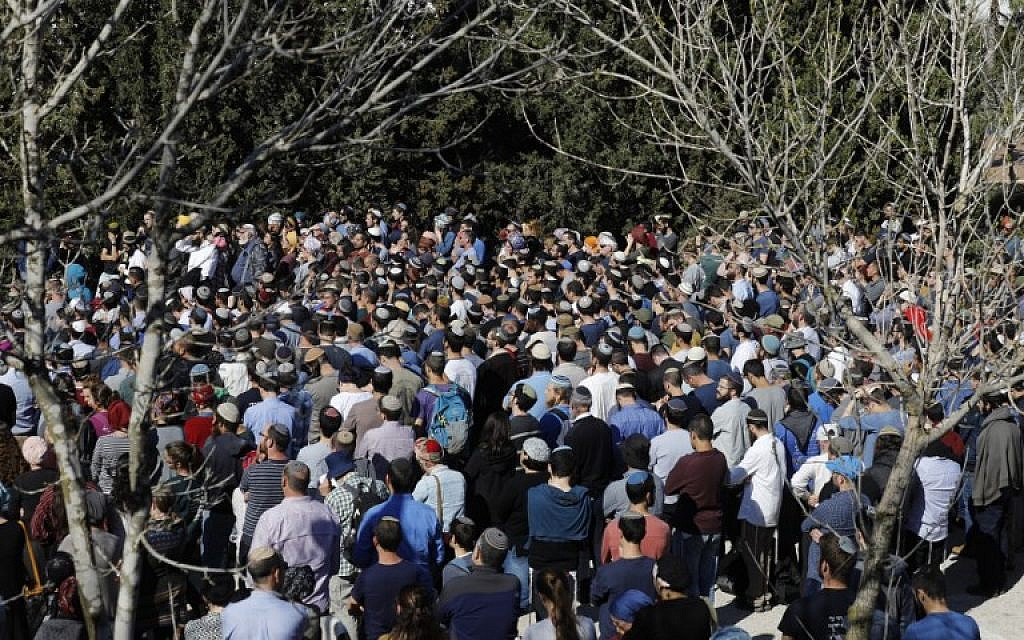Mourners in the West Bank settlement of Eli, attend the funeral of 47-year-old Rabbi Achiad Ettinger, who died from his injuries sustained a day earlier during a gun and knife attack, on March 18, 2019. (MENAHEM KAHANA / AFP)