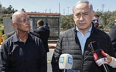 Prime Minister Benjamin Netanyahu visits the site of a terror attack at Ariel Junction in the northern West Bank, March 18, 2019. (Jack Guez / POOL / AFP)