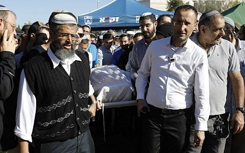 Mourners carry the body of 47-year-old rabbi Achiad Ettinger, who died from his injuries sustained a day earlier during a gun and knife terror attack, during his funeral in the West Bank settlement of Eli, on March 18, 2019. (MENAHEM KAHANA / AFP)