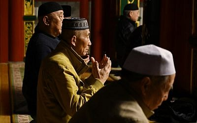 This photo taken on March 18, 2019 shows Muslim men praying at a mosque in Beijing. (GREG BAKER / AFP)