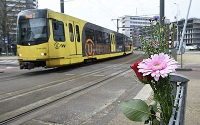 Flowers have been set up in tribute to victims at the site of a shooting in a tram, at 24 October square in Utrecht, on March 19, 2019, one day after three people were shot dead and several were injured in the attack. (Photo by JOHN THYS / AFP)