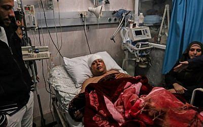 Atef Abu Seif, spokesman for Fatah in Gaza and a member of its central committee, lies in a hospital bed in Gaza City on March 19, 2019. (Mahmud Hams/AFP)