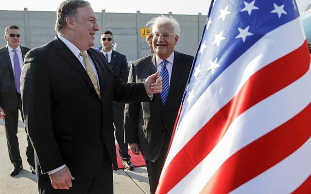 US Secretary of State Mike Pompeo (L) meets with US ambassador to Israel David Friedman (C) upon his arrival at Ben Gurion International Airport on March 20, 2019. (JIM YOUNG / POOL / AFP)