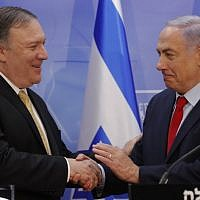 US Secretary of State Mike Pompeo, left, and Prime Minister Benjamin Netanyahu shake hands after delivering a joint statement during their meeting in Jerusalem on March 20, 2019. (Jim Young/AFP)