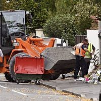 A digger delivers a load of gravel to the Al Noor mosque in Christchurch on March 21, 2019, six days after the twin mosque shooting massacre that claimed the lives of fifty people. (WILLIAM WEST / AFP)