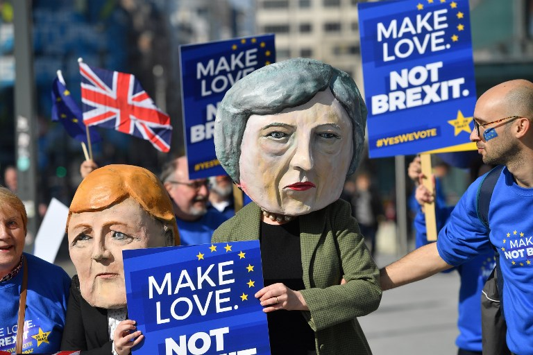 Britain calls for 'realism' on Brexit after parliament grabs control