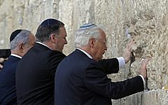 (L to R) Prime Minister Benjamin Netanyahu, US Secretary of State Mike Pompeo, and US ambassador to Israel David Friedman, touch the stones of the Western Wall in Jerusalem's Old City on March 21, 2019, during the second day of Pompeo's visit as part of his five-day regional tour of the Middle East. (Photo by JIM YOUNG / POOL / AFP)