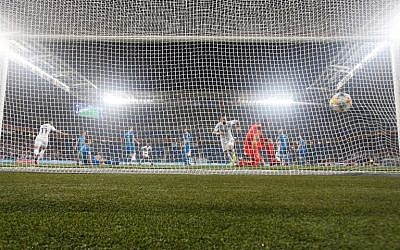 Slovenia's goalkeeper Jab Oblak concedes a goal to Israel's Eran Zahavi during the Euro 2020 Group G football qualification match between Israel and Slovenia at Sammy Ofer Stadium in Haifa on March 21, 2019. (Jack GUEZ / AFP)
