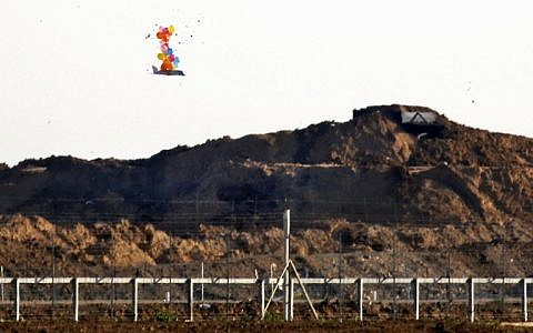 This picture from March 22, 2019, shows balloons carrying a make-shift drone-shaped object flying over the border with Israel east of Gaza City, after it was launched by Palestinians during clashes along the security fence. (Said Khatib/AFP)