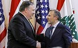 Lebanese Foreign Minister Gibran Bassil (R) shakes hands with visiting US Secretary of State Mike Pompeo following a public statement in the Lebanese capital Beirut on March 22, 2019. (Jim Young/Pool/AFP)
