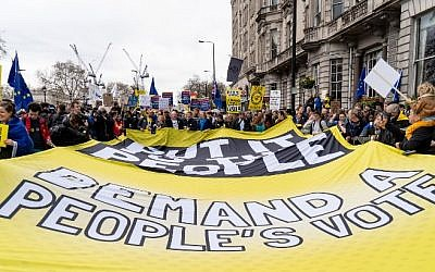 """People unfurl a large banner calling for a """"People's Vote"""" as they attend a march and rally organized by the pro-European People's Vote campaign for a second referendum in central London on March 23, 2019. (Niklas Halle'n/AFP)"""