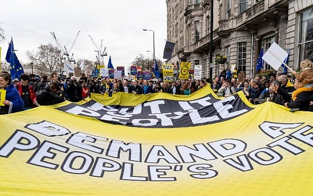 "People unfurl a large banner calling for a ""People's Vote"" as they attend a march and rally organized by the pro-European People's Vote campaign for a second referendum in central London on March 23, 2019. (Niklas Halle'n/AFP)"
