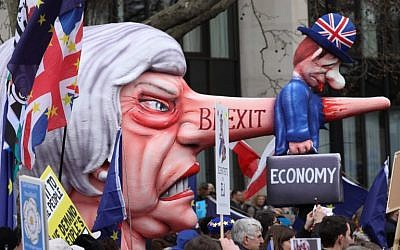 A puppet head of Britain's Prime Minister Theresa May spearing a representation of the British Economy is taken on a march and rally organized by the pro-European People's Vote campaign for a second EU referendum in central London on March 23, 2019. (Isabel Infantes/AFP)