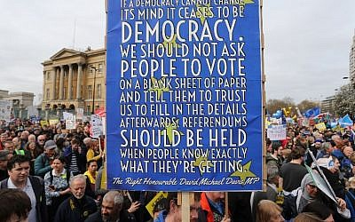 People hold up placards and European flags as they attend a march and rally organised by the pro-European People's Vote campaign for a second EU referendum in central London on March 23, 2019. (Isabel INFANTES / AFP)