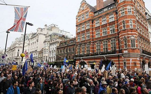 People hold up placards and European flags as they take part in a march and rally organised by the pro-European People's Vote campaign for a second referendum in central London on March 23, 2019. (Isabel INFANTES / AFP)