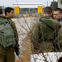Israeli soldiers are seen at the Quneitra border crossing in the Golan Heights, on March 23, 2019, ahead of demonstrations over US President Donald Trump's recognition of Israeli sovereignty over the area. (Jack Guez/AFP)