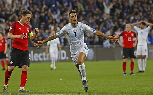 Israel's midfielder Eran Zahavi celebrates after scoring his hat trick during the Euro 2020 Group G football qualification match between Israel and Austria at the Sammy Ofer Stadium in Haifa on March 24, 2019. (Jack GUEZ / AFP)