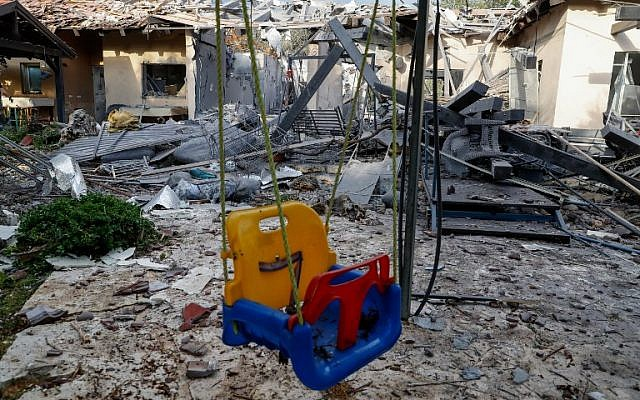 An infant's swing outside the home of the Wolf family in the central Israeli village of Mishmeret, which was destroyed in the early morning hours of March 25, 2019 by a rocket fired from Gaza. (Jack Guez/AFP)