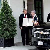 US President Donald Trump, left, and Israel's Prime Minister Benjamin Netanyahu hold up a Golan Heights proclamation outside the West Wing after a meeting in the the White House in Washington, DC, March 25, 2019.(Brendan Smialowski/AFP)