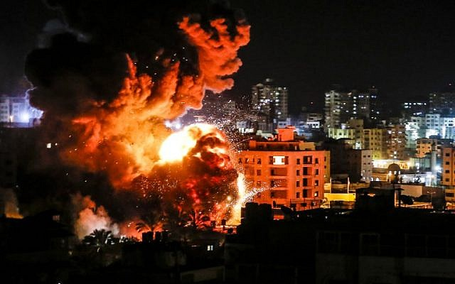 Fire and smoke around buildings in Gaza City during reported Israeli strikes on March 25, 2019. (Mahmud Hams / AFP)