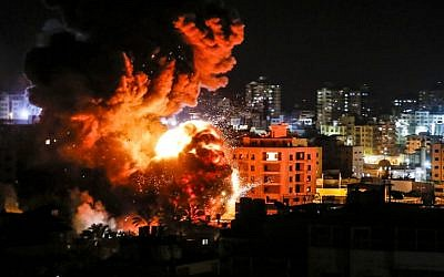 A ball of fire bellows above buildings in Gaza City during Israeli strikes on March 25, 2019. (Mahmud Hams/AFP)
