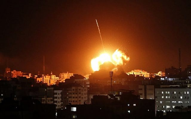 A ball of fire lights the sky above a building believed to house the offices of Hamas chairmain Ismail Haniyeh, during Israeli strikes on Gaza City hours after a rocket from the Palestinian enclave hit a house and wounded seven Israelis on March 25, 2019. (Mahmud Hams / AFP)