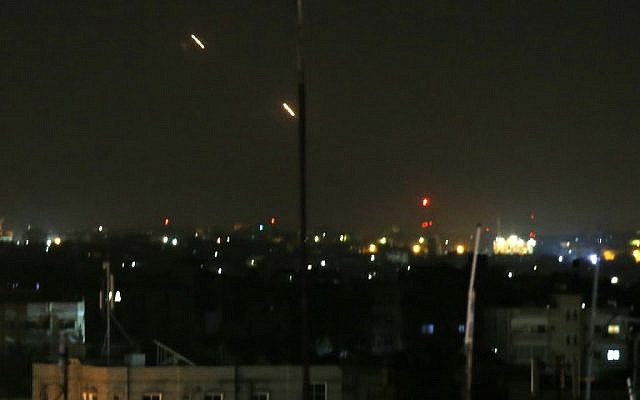 Illustrative: Rockets are fired from the Gaza Strip toward Israel on March 25, 2019. (Said Khatib/AFP)