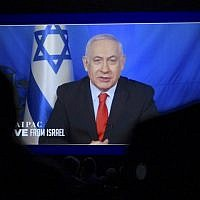 Prime Minister Benjamin Netanyahu speaks from Israel via video link at the annual AIPAC conference in Washington on March 26, 2019. ( Jim Watson/AFP)