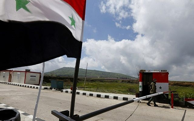 A member of the Syrian security forces walks near the border post with Israel in the Syrian town of Quneitra in the Golan Heights on March 26, 2019. (Louai Beshara/AFP)