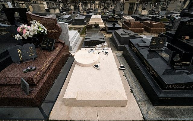 The vandalized grave of US photographer and artist Man Ray and his wife, US dancer and model Juliet Man Ray at the Montparnasse cemetery in Paris on March 27, 2019. (Lionel Bonaventure/AFP)