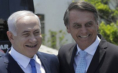 In this photo from December 28, 2018, Prime Minister Benjamin Netanyahu (L) is welcomed by Brazil's then president-elect Jair Bolsonaro at the Copacabana fort in Rio de Janeiro, Brazil. (Leo Correa/Pool/AFP)