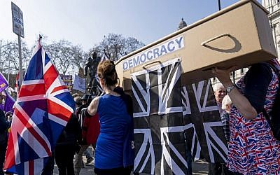 Pro-Brexit demonstrators carry a coffin representing the death of democracy as protesters gather in Parliament Square in central London on March 29, 2019. (Niklas Halle'n/AFP)