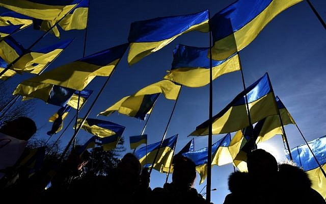 Supporters hold Ukrainian flags during former Ukrainian prime minister and now presidential candidate Yulia Tymoshenko's pre-election rally in Kiev, on March 29, 2019, ahead of the presidential election on March 31. (Vasily Maximov/AFP)