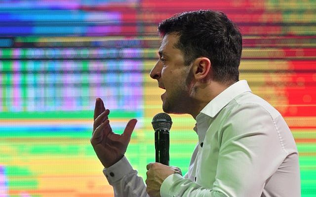 """Ukrainian comic actor, showman and presidential candidate Volodymyr Zelensky speaks as he performs with his """"95th block"""" comedy group in the small town Brovary, near Kiev, Ukraine, on March 29, 2019. (Genya Savilov/AFP)"""