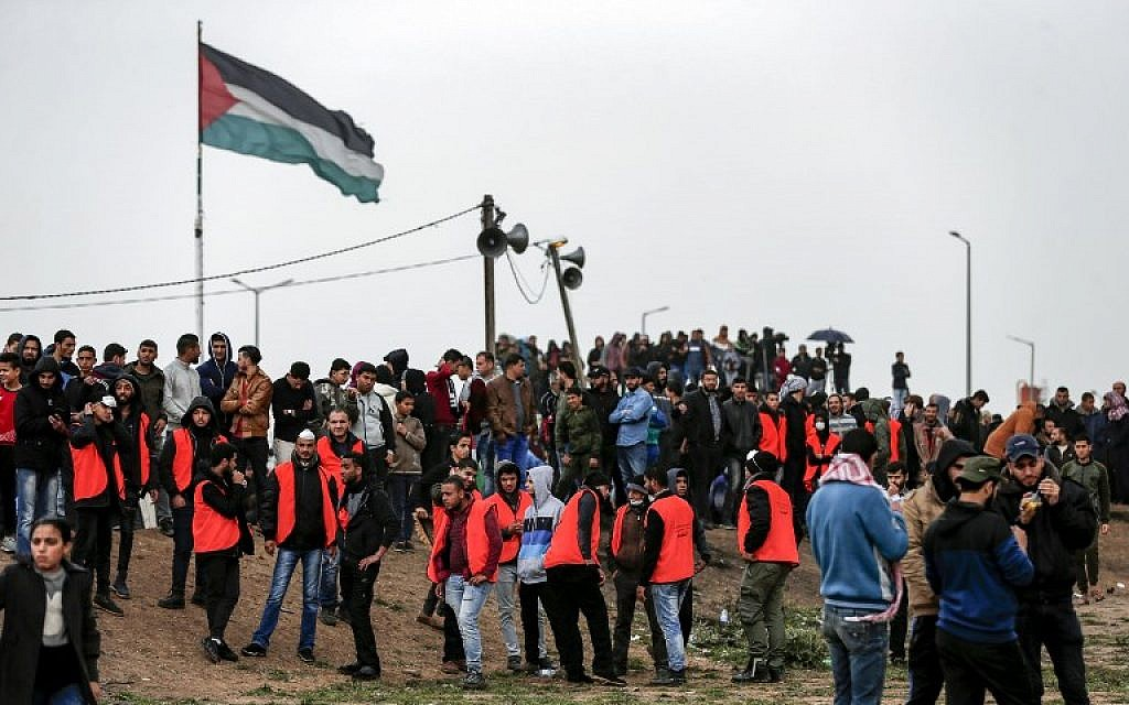 "Palestinians gather near the border with Israel in Malaka east of Gaza City on March 30, 2019, as they mark the anniversary of the ""March of Return"" border protests. (Mahmud Hams/AFP)"