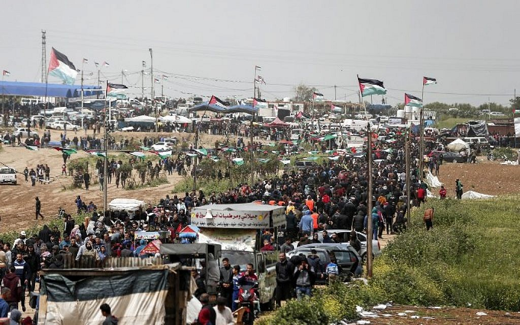 Palestinians gather near the border with Israel in Malaka east of Gaza City on March 30, 2019, as they mark the first anniversary of the 'March of Return' border protests. (Mahmud Hams/AFP)