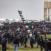 "Palestinians gather near the border with Israel in Malaka east of Gaza City on March 30, 2019, as Palestinians mark the first anniversary of the ""March of Return"" border protests. (Mahmud Hams/AFP)"