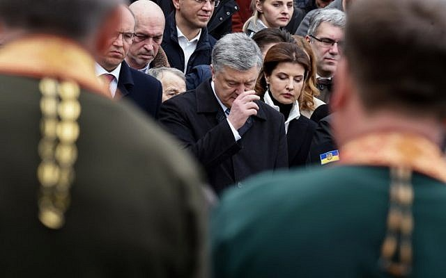 Ukrainian President Petro Poroshenko, center, and his wife Maryna, center right, take part in an open air prayer for fair elections served by the priests of the Orthodox Church of Ukraine and the other confessions in Kiev, on March 30, 2019, on the eve of the Ukrainian presidential election. (Sergei Gapon/AFP)