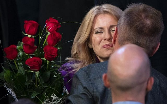 Presidential candidate Zuzana Caputova receives flowers and is congratulated by supporters at her headquarters in Bratislava, Slovakia on March 30, 2019 after taking a big lead in the presidential elections. - Vocal government critic and anti-corruption activist Zuzana Caputova appeared set to become Slovakia's first female president after partial results showed her winning the run-off election of March 30, 2019. Environmental lawyer Caputova got 58.07 percent of the ballot after results from 51 percent of polling stations were counted, while EU energy commissioner Maros Sefcovic garnered 41.92, the Slovak Statistics Office said. (Photo by JOE KLAMAR / AFP)
