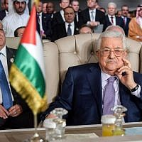Palestinian Authority President Mahmoud Abbas (R) and Palestine Liberation Organization (PLO) Executive Committee Secretary-General Saeb Erekat (L) attend the opening session of the 30th Arab League summit in the Tunisian capital Tunis on March 31, 2019. (Fethi Belaid/Pool/AFP)