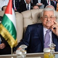 Palestinian Authority President Mahmoud Abbas (R) and and Palestine Liberation Organization Secretary-General Saeb Erekat (L) attend the opening session of the 30th Arab League summit in the Tunisian capital Tunis on March 31, 2019. (Fethi Belaid/Pool/AFP)